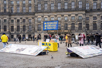Falun Gong Demonstrators in Action Amsterdam 190131-1