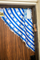 Triangular Flag Shawl on Door 190513-1