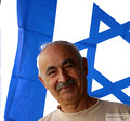 Portrait of Local Shop Owner and Israel Flag